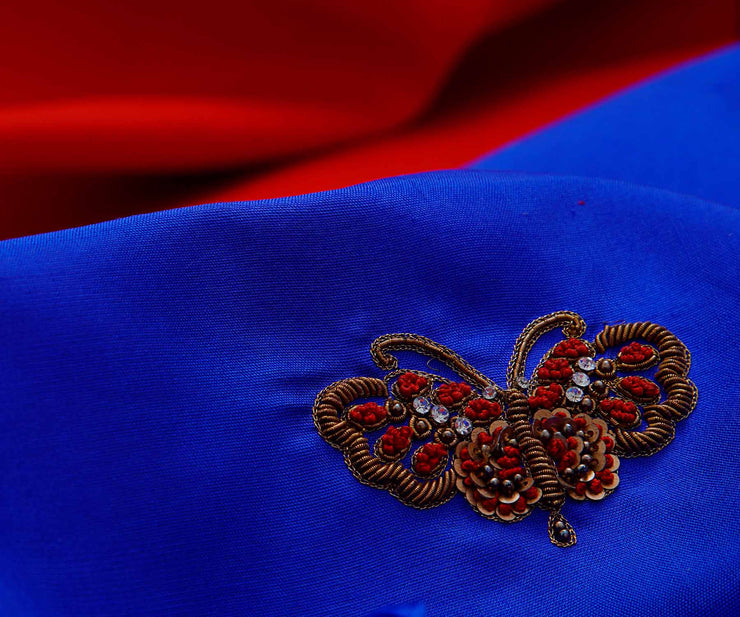 Red Kanchi Silk Saree with Royal Blue Pallu Crafted with Butterfly Embroidery