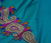 Bluish Green Kanchi Silk Saree Crafted with Mango Zari Load Embroidery and Swarovski Stone Buttas All Over In Saree
