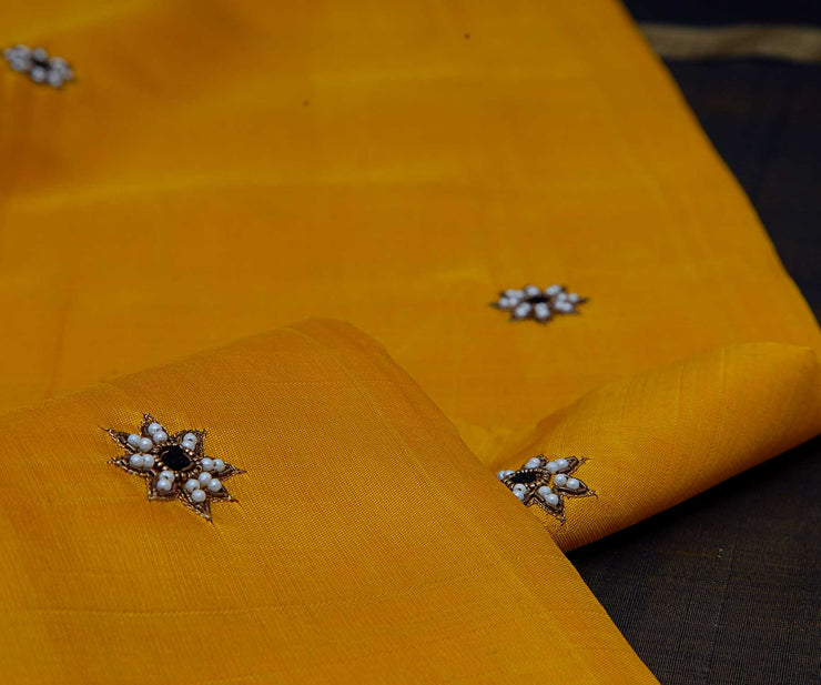 Yellow Korvai Kanchi Silk Saree with Floral Pearl Butta and Black Tissue Pallu