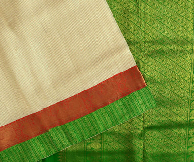 Half White Checked Tussar Saree With Orange And Green Border And Orange Kanchi Silk Blouse