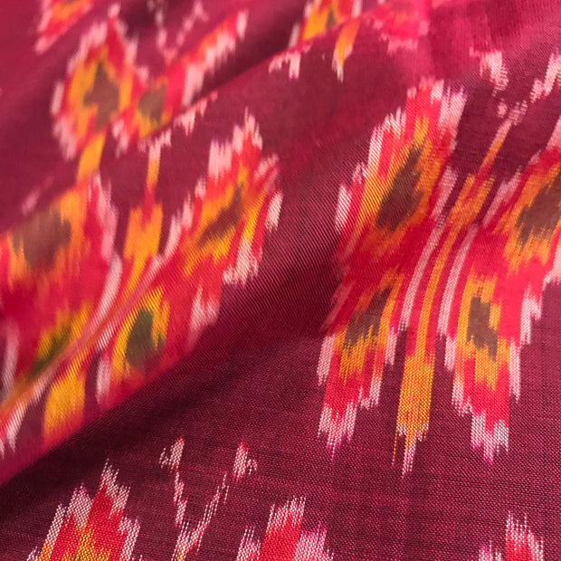 Maroonish Ikkat silk fabric
