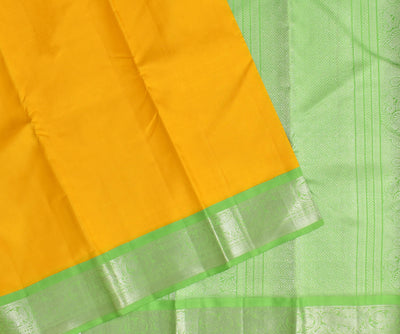 Yellow Kanchi Silk Saree With Parrot Green Silver Zari Border