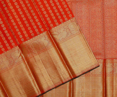 Orangish Red Kanchi Silk Saree with Mayil Chakra on Body and Grand Zari Border and Pallu