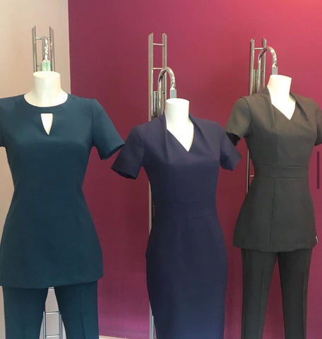 A range of three Florence Roby uniforms showing different sizes