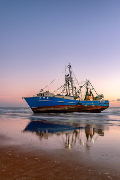 A photo of a beached shrimp boat