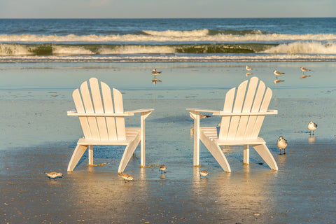 A photo of a pair of Adirondack Chairs on the beach