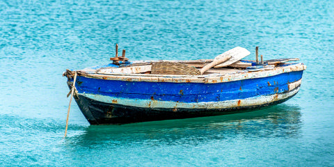 A photo of a blue Haitian fisherman's boat in the Caribbean
