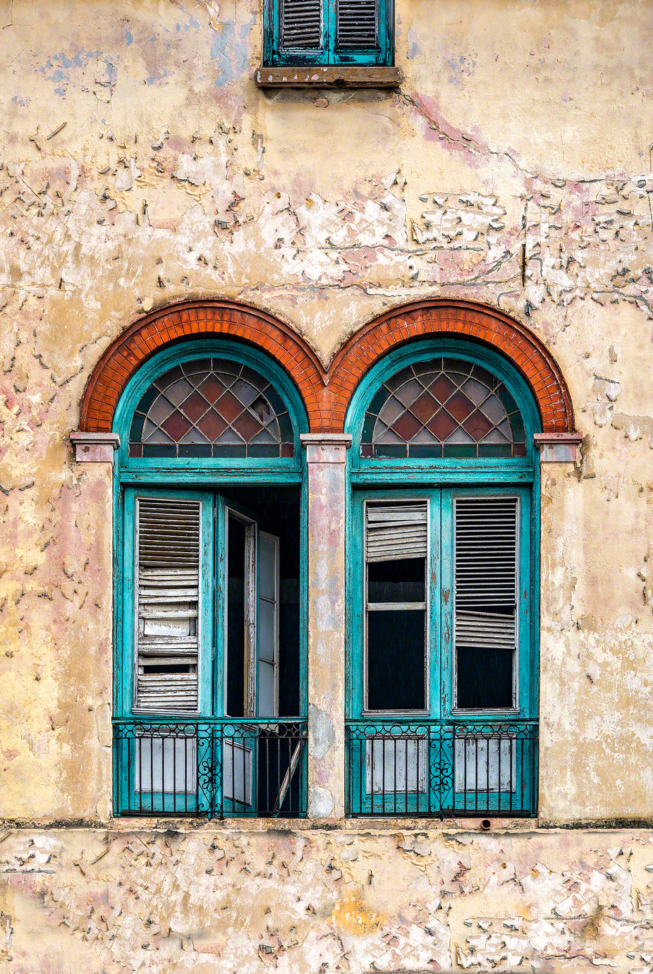 A photo of old turquoise colored shutters in Havana, Cuba