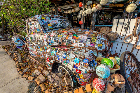 A photo of an old truck with stickers all over it at Bo's Fish Wagon restaurant in Key West Florida