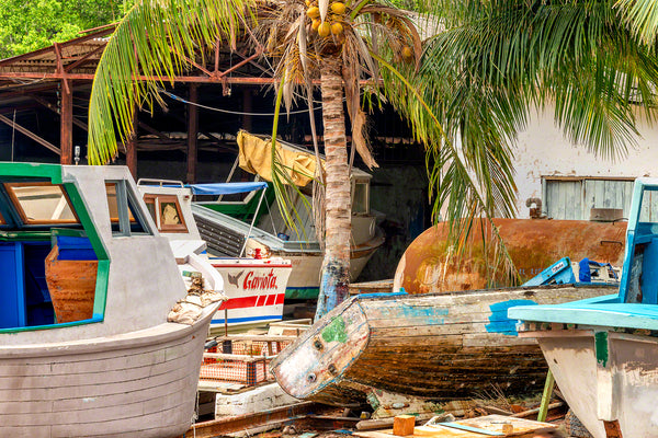 A photo of a group of rustic boats in a boat yard in Cojimar, Cuba