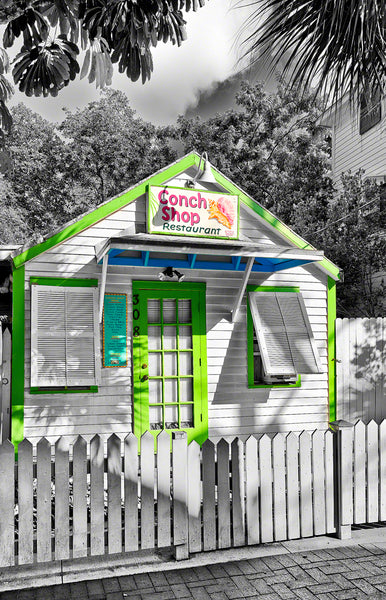 a photo of a  small colorful conch shack in Key West, Florida