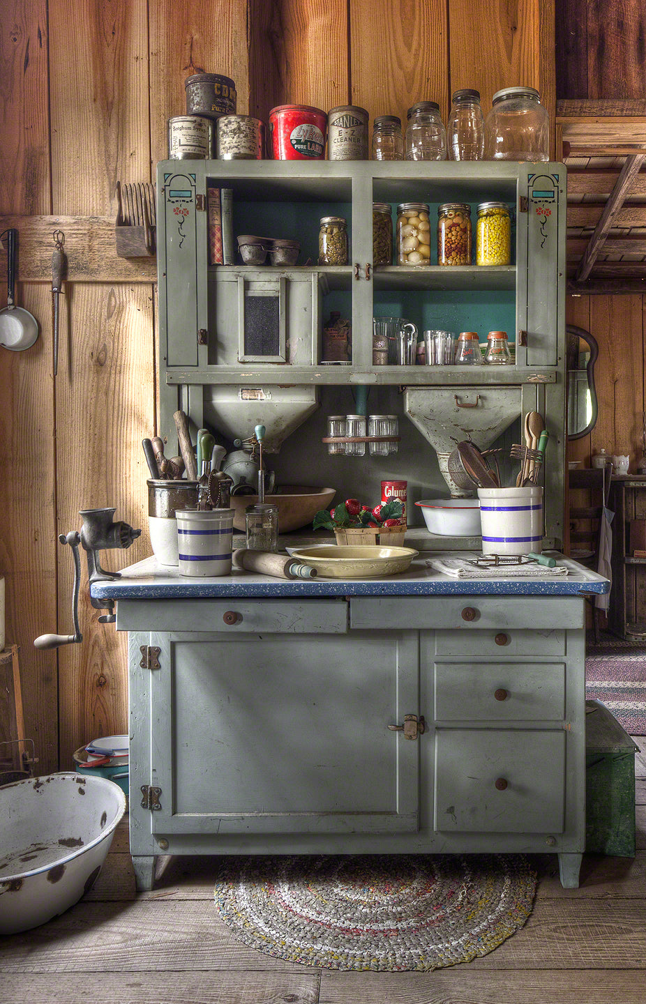 A photo of an old canning and baking hutch
