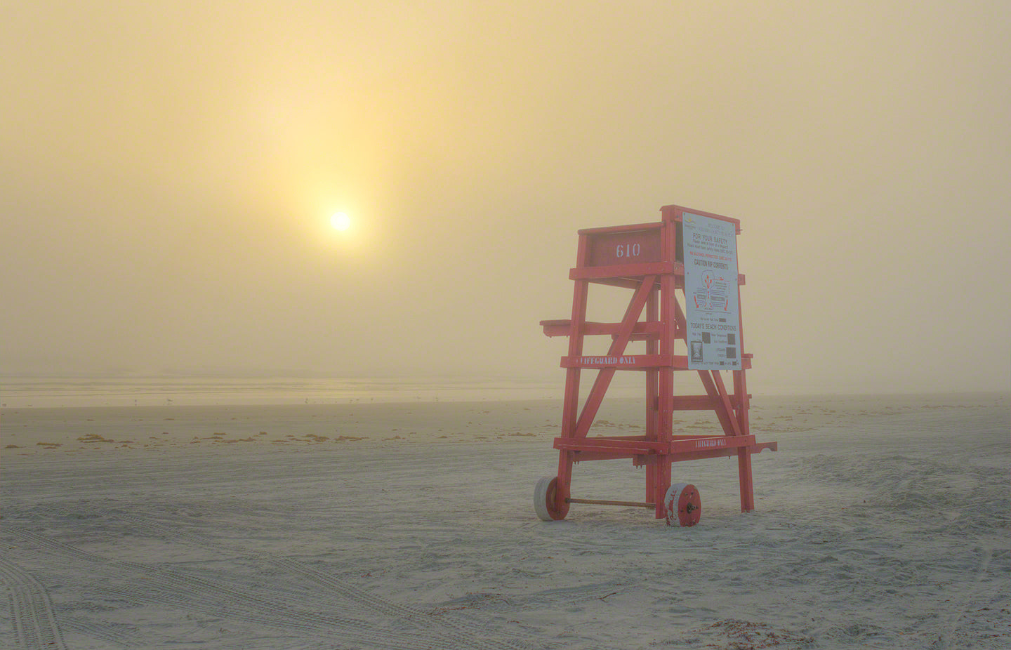 A photo of a red life guard stand on the beach