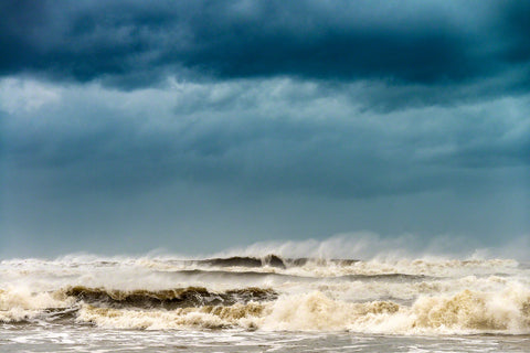 A photograph of huge surf and dark sky from Hurricane Dorian by Mike Ring