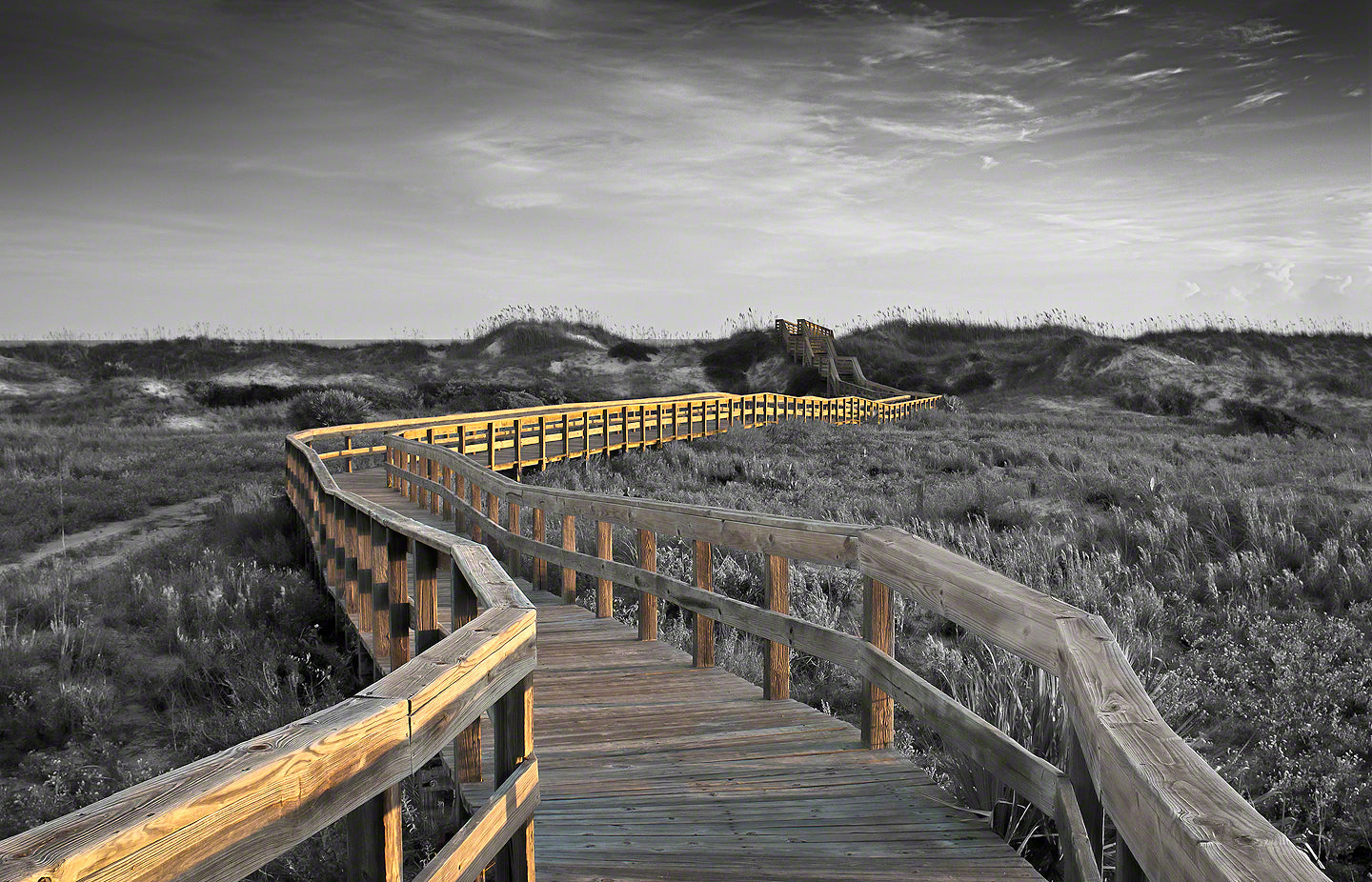 A photo of a boardwalk at sunrise in Smyrna Dunes Park