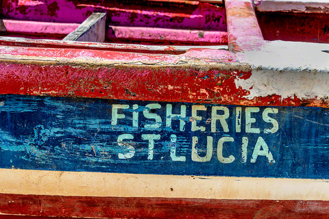 A colorful rustic fishing boat ready for the next adventure