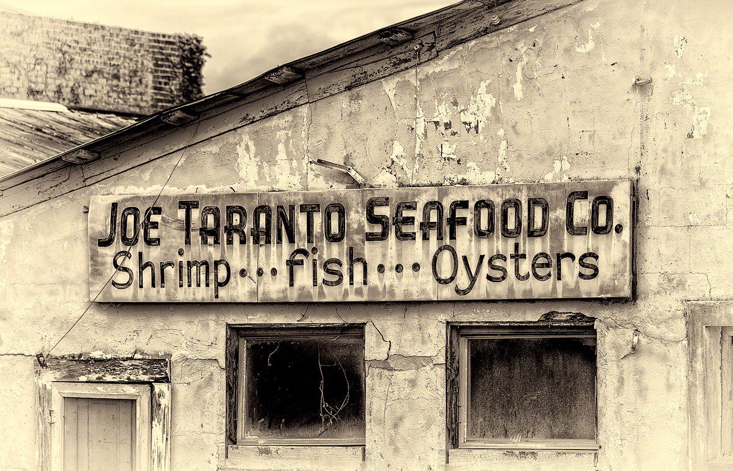 A Landscape Fine Art Photograph by Mike Ring of an old rustic seafood house.