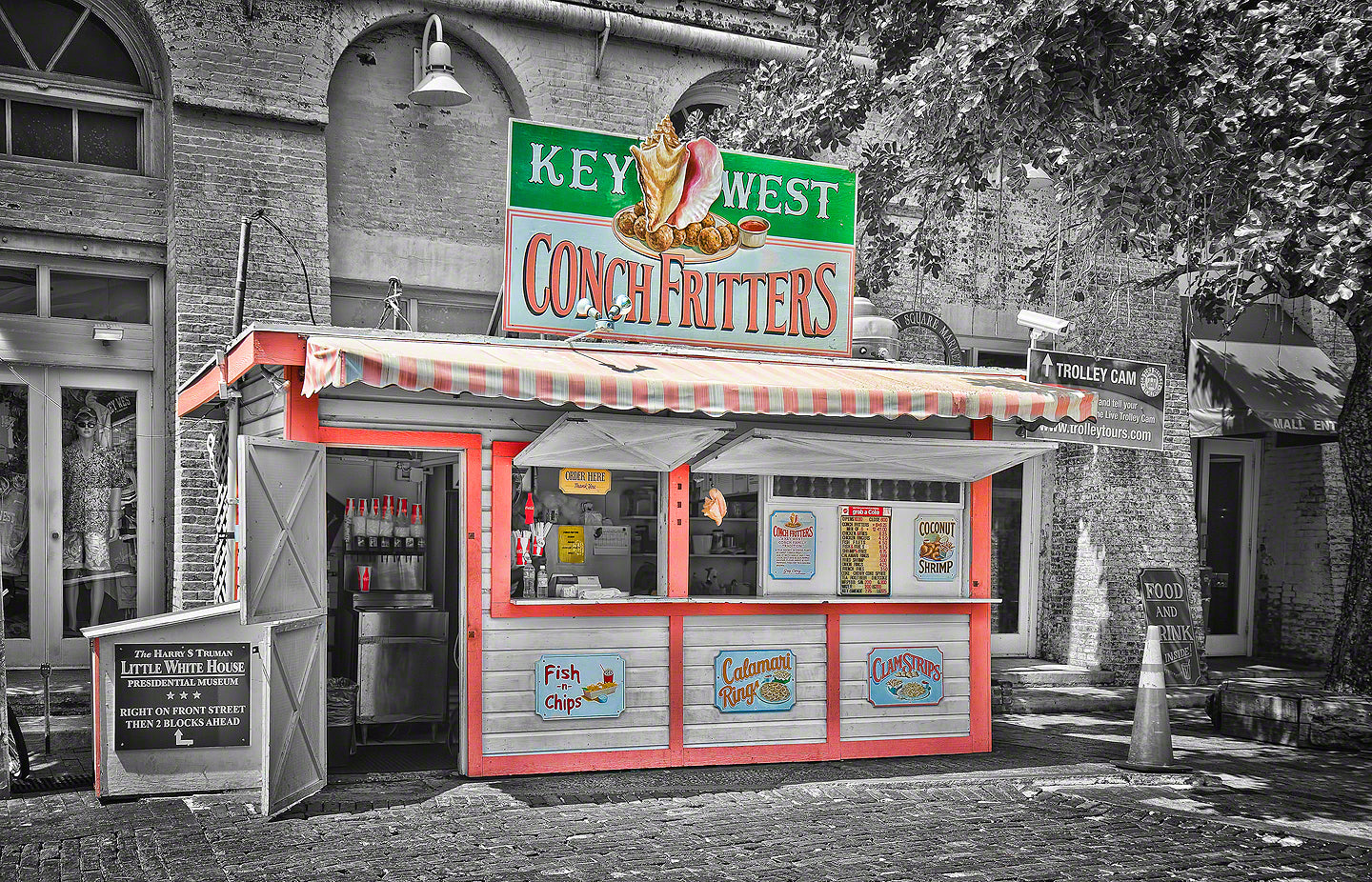A photo of a colorful conch fritter stand in Key West, Florida