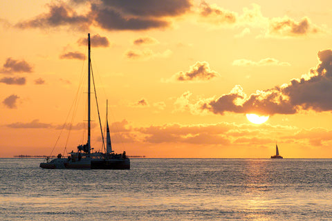 A photo of sailboats watching the sunset celebration in Key West, Florida