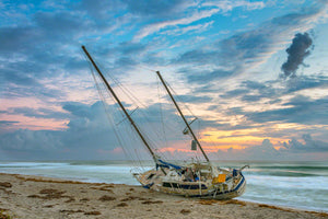 A photo of a beached sailboat after a hurricane