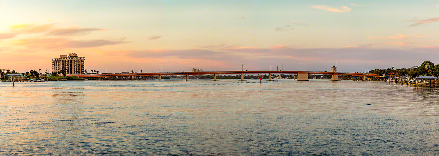 A panoramic sunset view of the North Causeway bridge in New Smyrna Beach, Florida