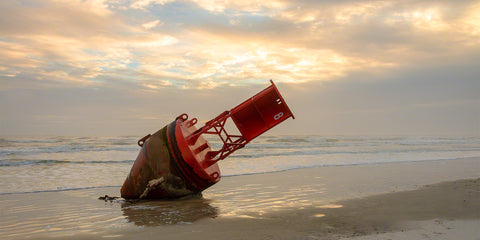 A photo of a Red Buoy that washed ashore in New Smyrna Beach