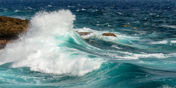 A photo of large crashing waves along the rocky windward coast on the island of Curacao