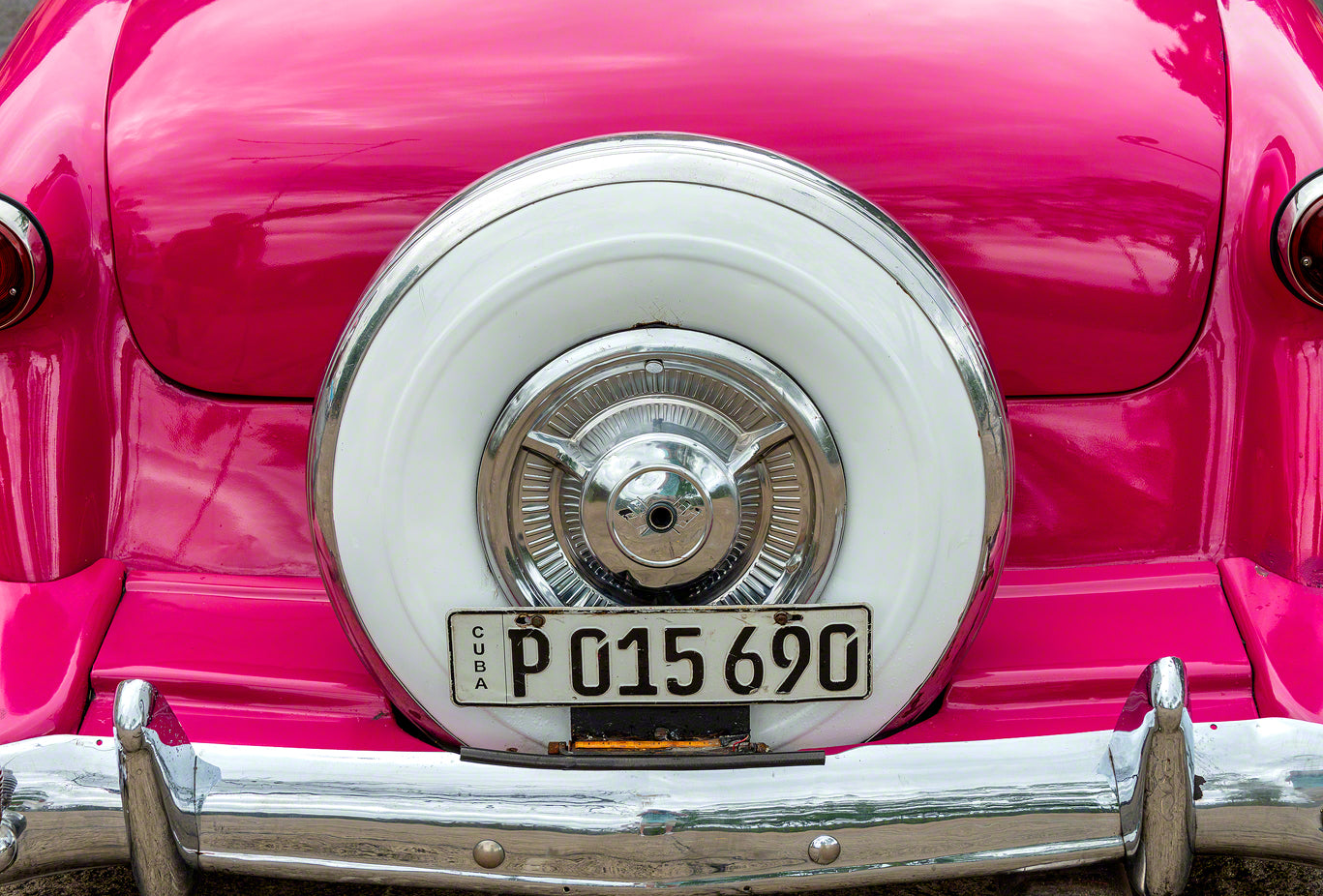 A pink classic American car used as a taxi in Havana Cuba