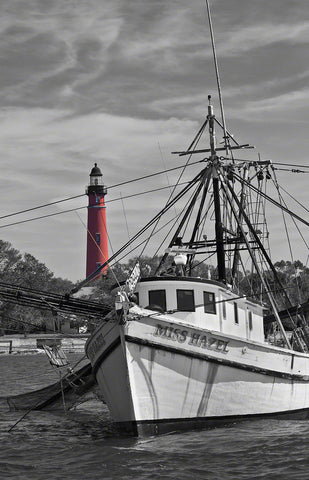 A photo of the Ponce Inlet Lighthouse with the Miss Hazel shrimp boat
