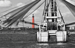 A photo of the Ponce Inlet Lighthouse and Lady Barbara shrimp boat