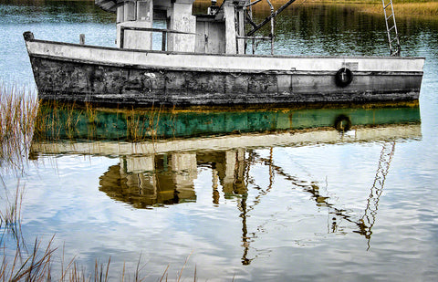 A photo of an old shrimp boat