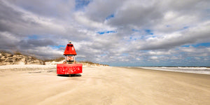 A panoramic photograph by Mike Ring of a lost red buoy on Cumberland Island, Georgia.