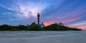 A landscape photograph by Mike Ring of the Sanibel Lighthouse at sunset