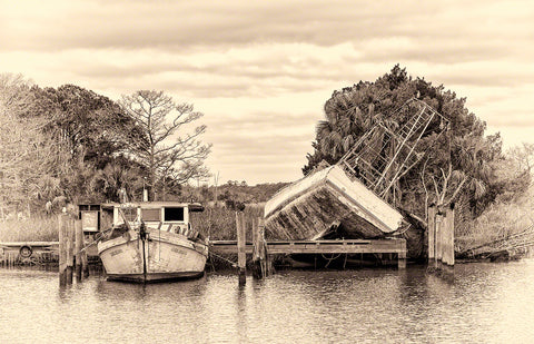 A photo of a wrecked shrimp boat from a hurricane