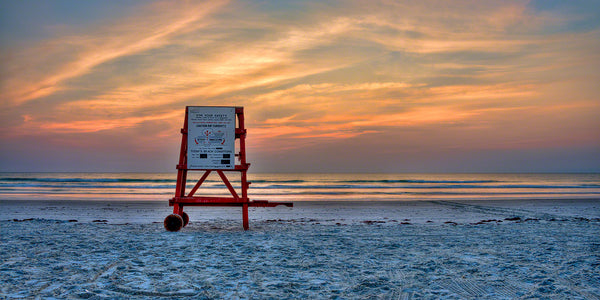 A photo of a life guard stand at sunrise