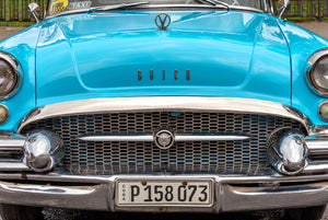 A photo of an old classic American car used as a taxi in Cuba