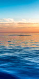 A photo of sunset light over calm blue Caribbean waters