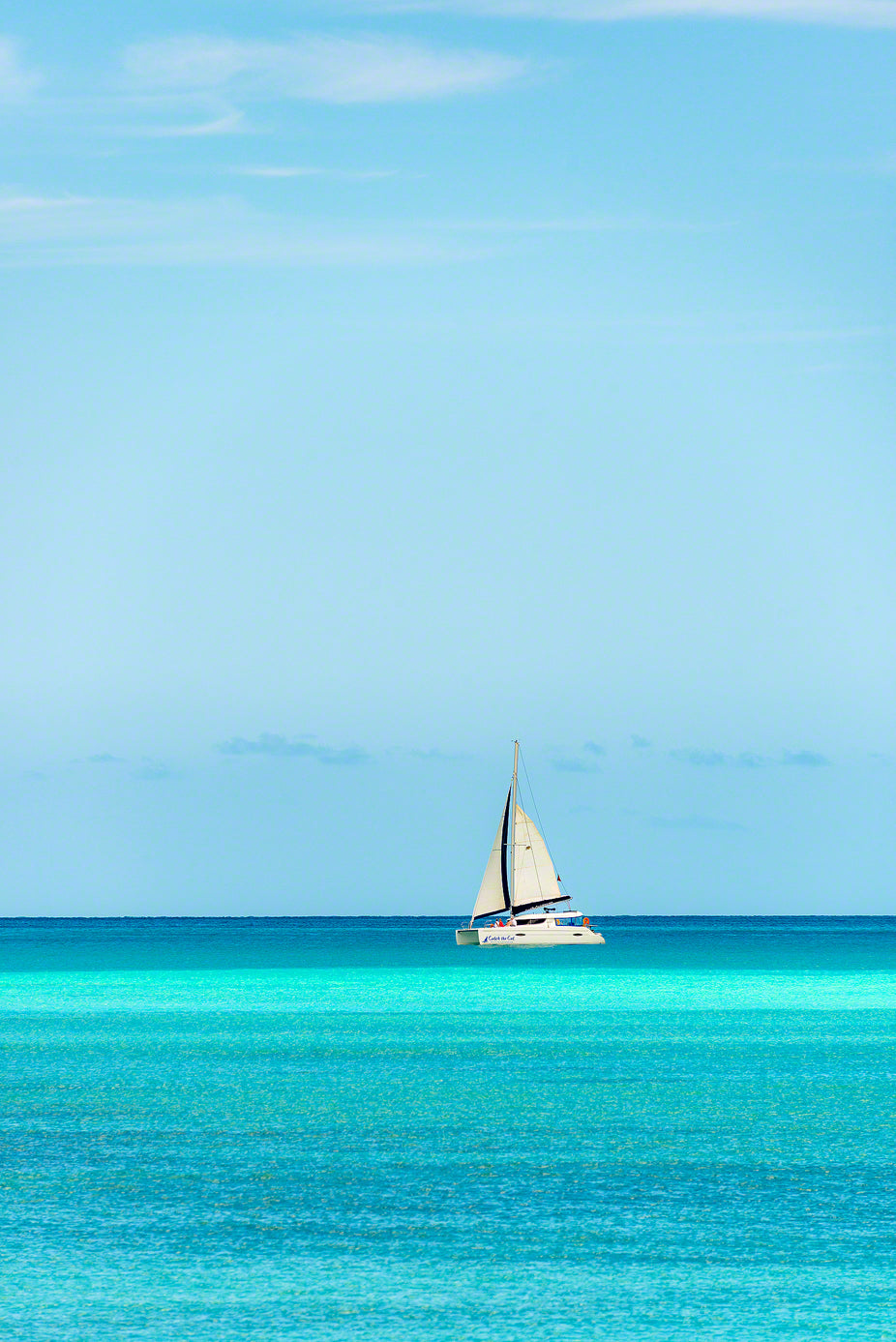 A sailboat taking tourists for a peaceful ride along the coast in Antigua