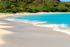 A photo of the surf and sand at beautiful Valley Church Beach in Antigua