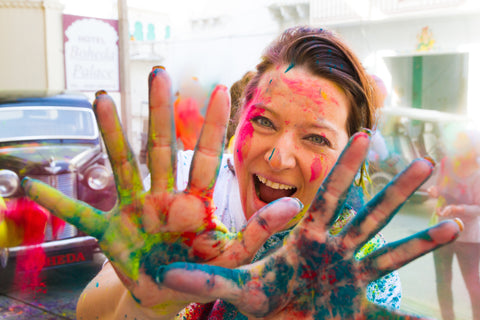 Women at church event with color powder