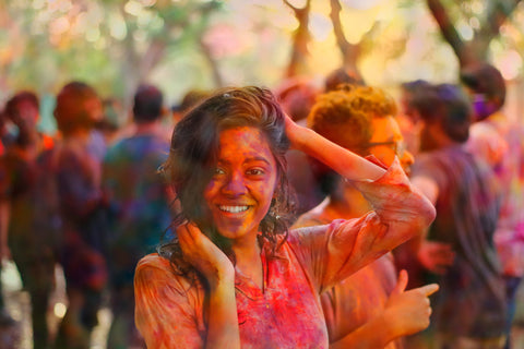 Girl at Holi festival by Captain Colors
