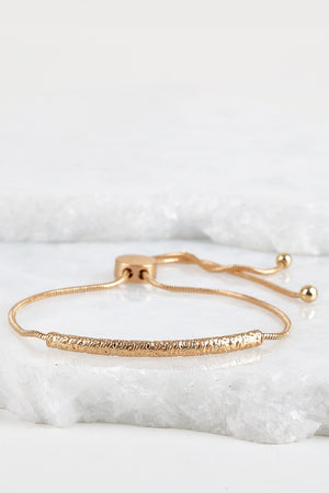 Gold Curved Textured Metal Bar Bracelet