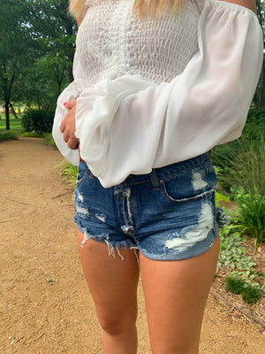 DARK DISTRESSED HIGH ROLLED UP SIDE DENIM SHORTS