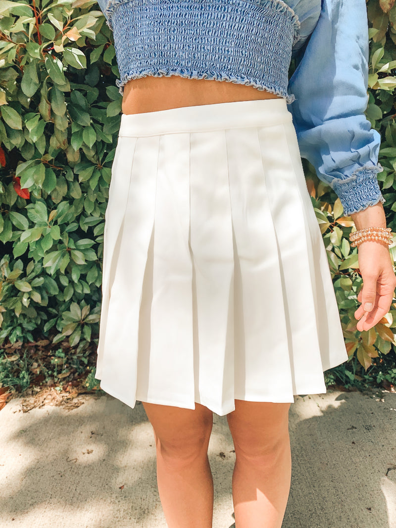 PLEATED TENNIS MINI SKIRT