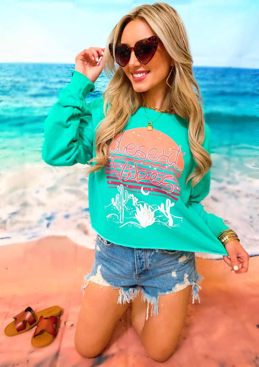 JADE ACID WASHED GRAPHIC CROPPED SWEATSHIRT