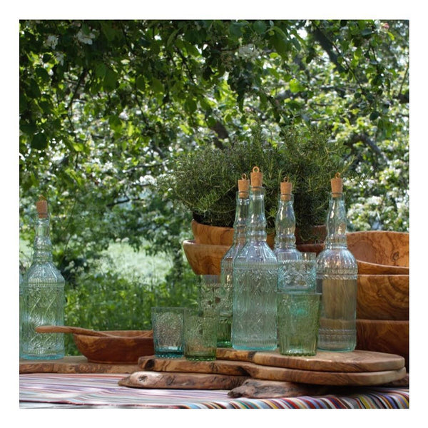 group of bottles in clear recycled glass