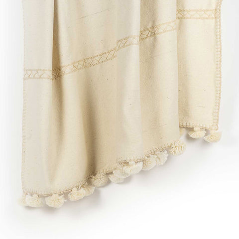Handwoven white blanket with pompom