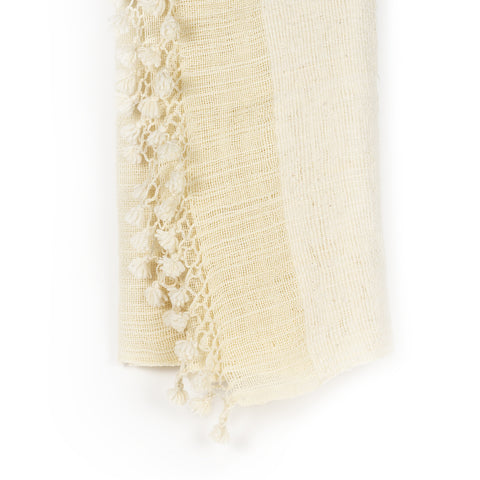 White handmade blanket with pom pom