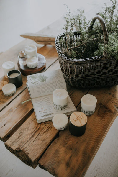 Moodpicture candles and basket on wooden table Munio Candela