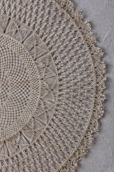 detail of jute wall hanging in macramé woven in circular rows